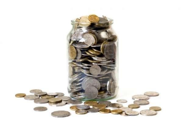 Overflowing jar of Australian coins